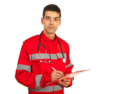 Paramedic man taking notes and standing in semi profile isolated on white background photo
