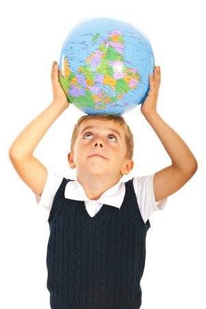 School boy holding world globe on head and looking up isolated on white background photo