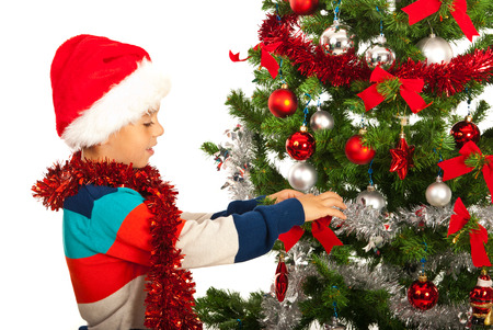 decore: Christmas happy boy decore tree with red and silver balls Stock Photo