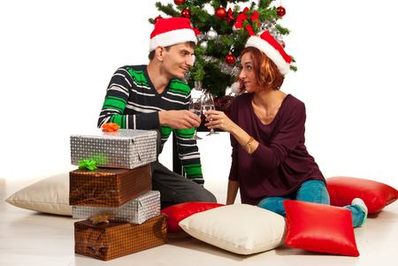 Young couple toasting and celebrate Christmas  photo