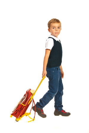 schoolbag: Schoolboy with schoolbag going to school isolated on white