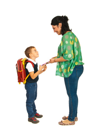 Mother prepare boy for school and giving him notebooks photo