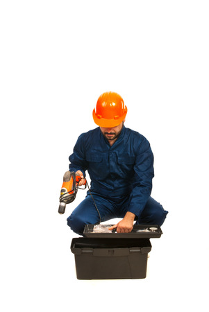 Electrician worker with utensils box isolated on white background photo