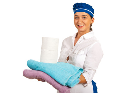 Happy maid holding clean towels and rolls of toilet paper isolated on white background Stock Photo - 22926400