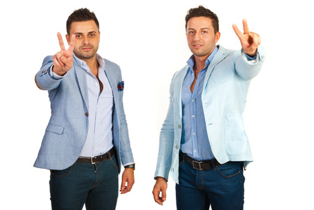 Victorious two business men isolated on white background photo
