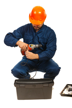 Worker man with tools box isolatedon white background photo