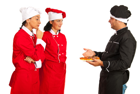 Chefteacher man talking with students women and showing pizza isolated on white background photo