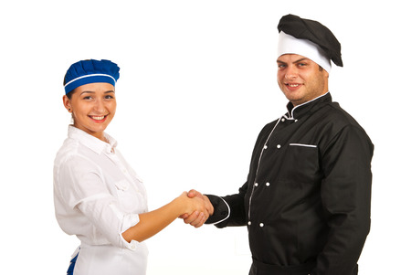 Chef male and waitress giving handshake isolated on white background photo