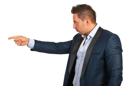accuser: Accuser executive man pointing to copy space isolated on white background Stock Photo