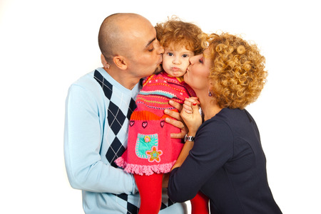 sulk: Parents kissing together their daughter with sulk face isolated on white background