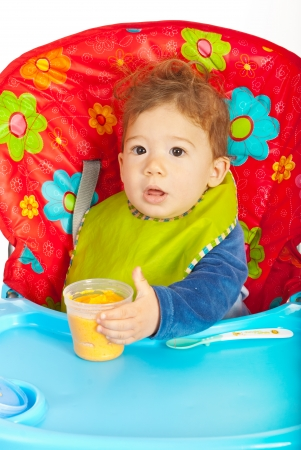 Baby boy sitting in chair and being ready for eat vegetables puree Stock Photo - 23165752