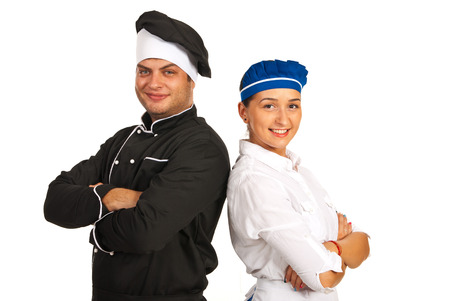 Happy chef male and waitress standing back to back with hands crossed photo
