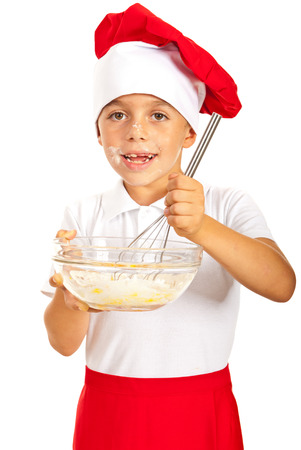 Cheerful chef boy mixing ingredients in a bowl Stock Photo - 23166003