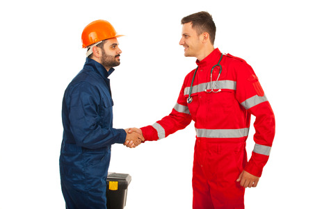 impressions: Parmaedic and constructor worker meeting and giving hand shake isolated on white background Stock Photo