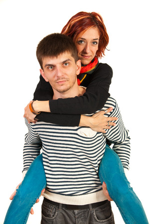 Man offering piggy back ride to woman isolated on white background photo