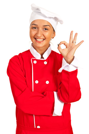 Happy chef woman showing okay sign hand gesture isolated on white background photo