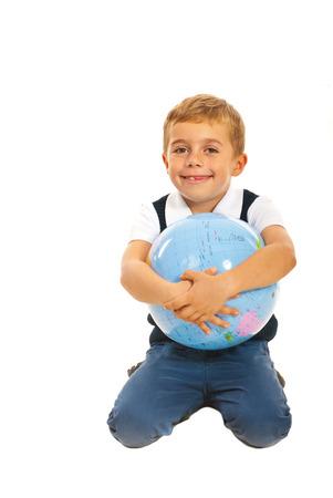 Happy boy embracing world globe isolated on white background photo