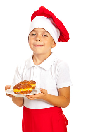 Happy chef boy holding donuts isolated on white background photo