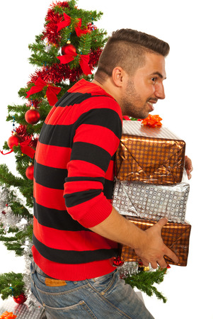 Rude man stolling Christmas presents isolated on white background photo