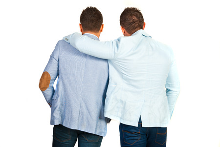 Back of business man friends standing in embrace isolated on white background photo