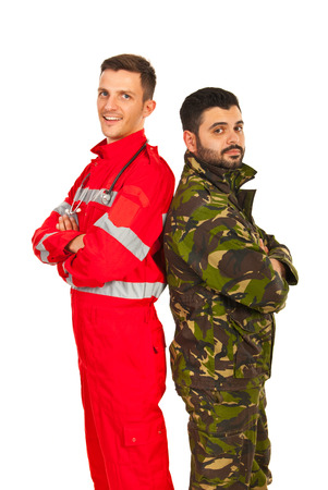 Soldier and paramedic man standing back to back with arms folded isolated on white  photo