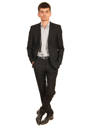 man legs: Full length of serious business man standing with legs crossed isolated on white background Stock Photo
