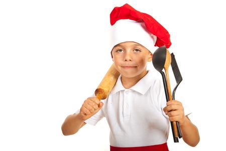 Chef  boy holding many utensils isolated on white background photo