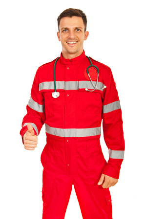 Happy paramedic man giving thumb up isolated on white background photo