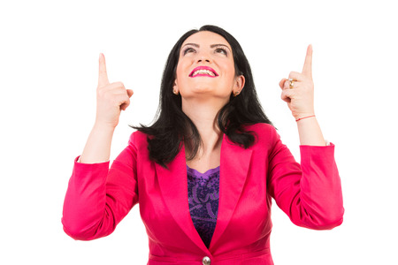 both: Happy woman pointing up to copy space with both hands isolated on white background