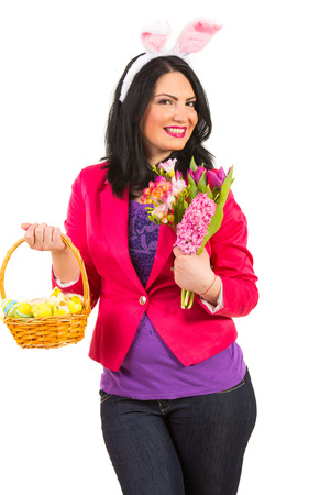 Beauty woman with bunny ears,basket with Easter eggs and fresh flowers of spring isolated on white background photo