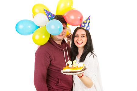 Happy couple celebrating woman birthday isolated on white background photo