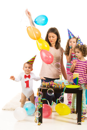 Happy family celebrating first year birthday of boy home photo