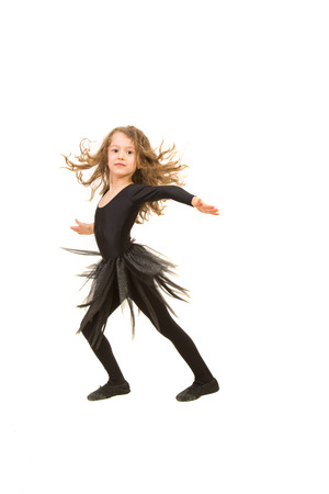 Beauty little dancer girl dancing isolated on white background photo
