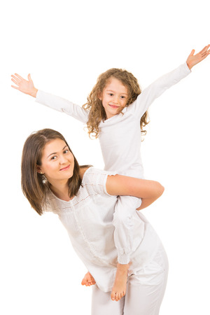 piggyback ride: Mother and daughter having fun together isolated on white background