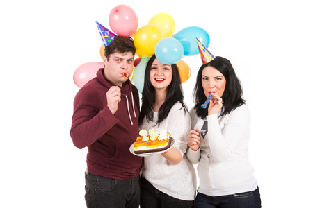 Cheerful three friends celebrate woman birthday isolated on white  photo