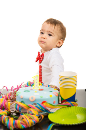 first birthday: First year birthday party of thinking little boy isolated on white background