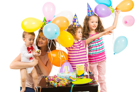 Happy birthday of toddler boy made first year and celebrate with his family photo