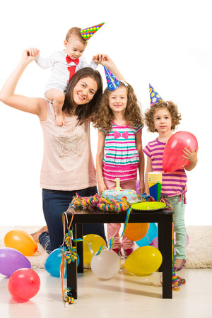 First year birthday of little boy celebrate with his family mother and sisters photo