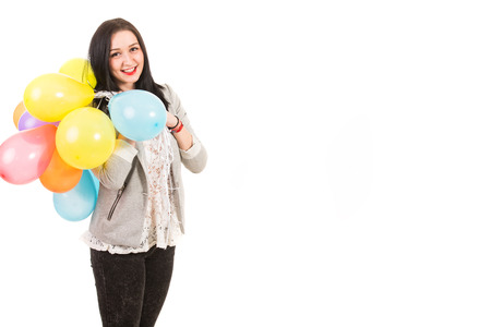 Happy woman with many balloons photo