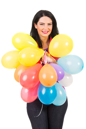 Smiling woman holding many colorful balloons isolated on white background photo