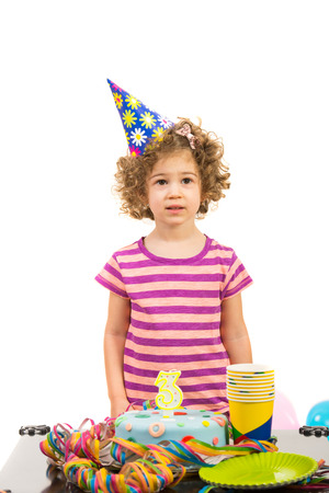 Birthday of little girl made three years age  against white background photo