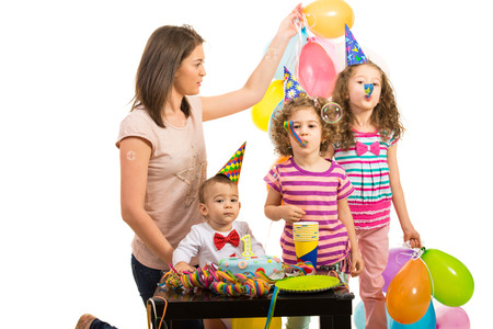Mother and their kids at birthday party toddler boy against white background photo