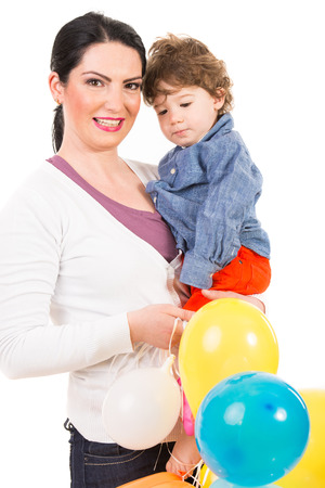 Happy mother and son holding colorful balloons isolated on white background photo