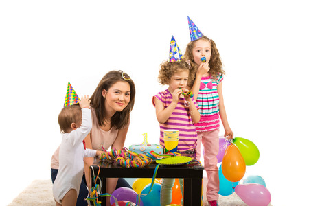 Mother and her three children having birthday party and celebrate first year of boy photo