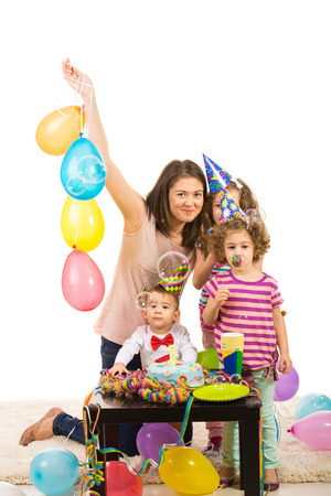 Happy birthday of toddler boy with cake,balloons and soap bubbles photo