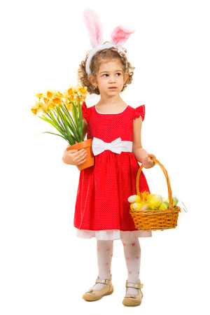Full length of little girl with Easter basket looking away to copy space isolated on white background photo