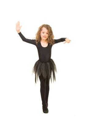 coreografia: Baile de la ni�a y hacer su coreograf�a aisladas sobre fondo blanco Foto de archivo
