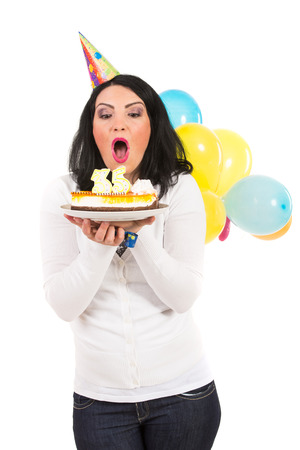 blow out: Birthday woman blowing cake candles isolated on white