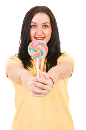 Happy woman offering big colorful lollipop isolated on white  photo