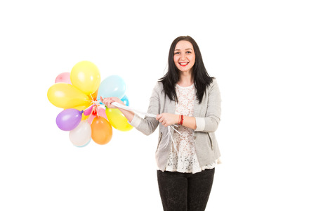 Happy woman holding many colorful balloons isolated on white background photo